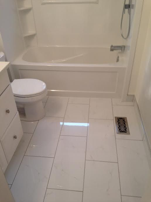 12 X 24 Ceramic Tile For The Floor White Cabinet Tub Toilet In Small Bathroom
