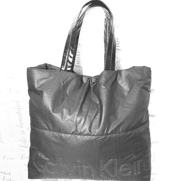 FINAL PRICEBlack Puffy Large Calvin Klein Tote Super awesome condition puffy black large tote with black patent handles. Black and silver interior, no stains or tears at all. Great everyday bag or overnight and even school. Lightweight and magnetic closure. Calvin Klein Bags Totes