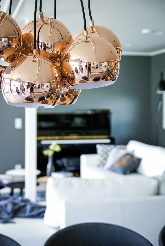 Tarja's Snowland, scandinavian interior design, black piano, living room, frandsen multi ball, copper light