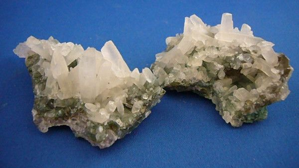 Dog Tooth Calcite Clusters Calcite works to cleanse the atmosphere of negativity and to amplify energy. It removes stagnant energy from the body and helps incre