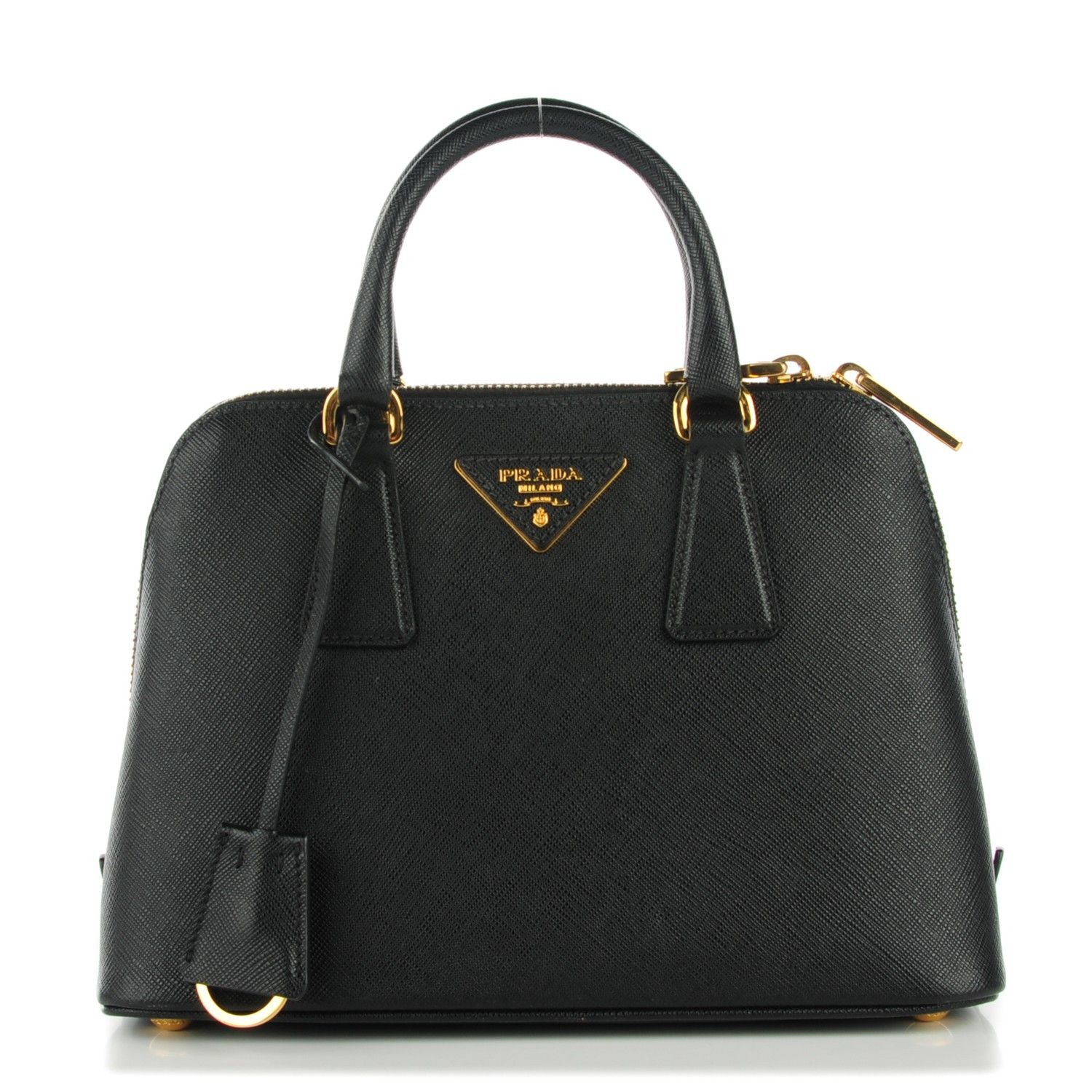 This is an authentic PRADA Saffiano Vernice Mini Promenade Nero Black.  This stunning tote is crafted of saffiano cross grain leather in black with gold hardware.  The bag features rolled leather top handles, an optional cross-body shoulder strap, and opens with a zipper  to partitioned jacquard interior with three compartments.  This is a marvelous tote, ideal for day as well as evening use, from Prada!