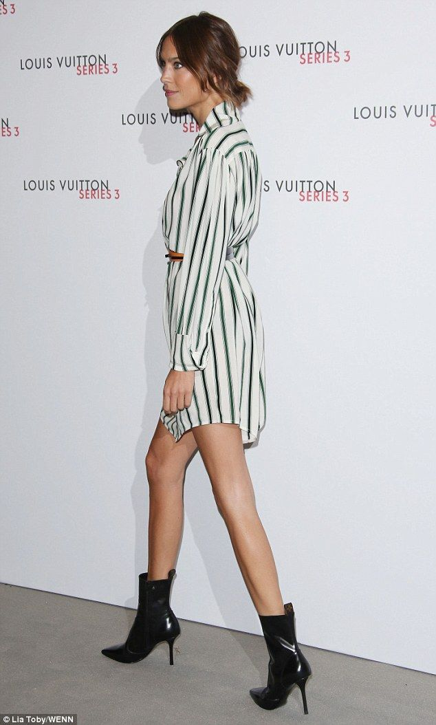 And... lunge! Alexa Chung put on a cool display in a mini striped shirt-dress with ankle boots
