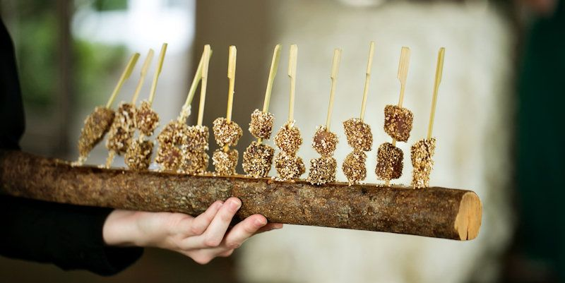 Amarynth Popcorn Crusted Tuna Skewers, served on a tree branch—a ...
