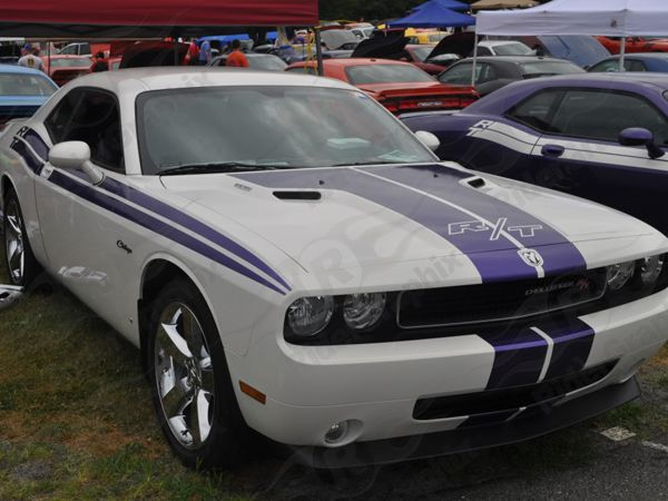 White Car With Purpel Stripes With Purple Stripes And Thought It