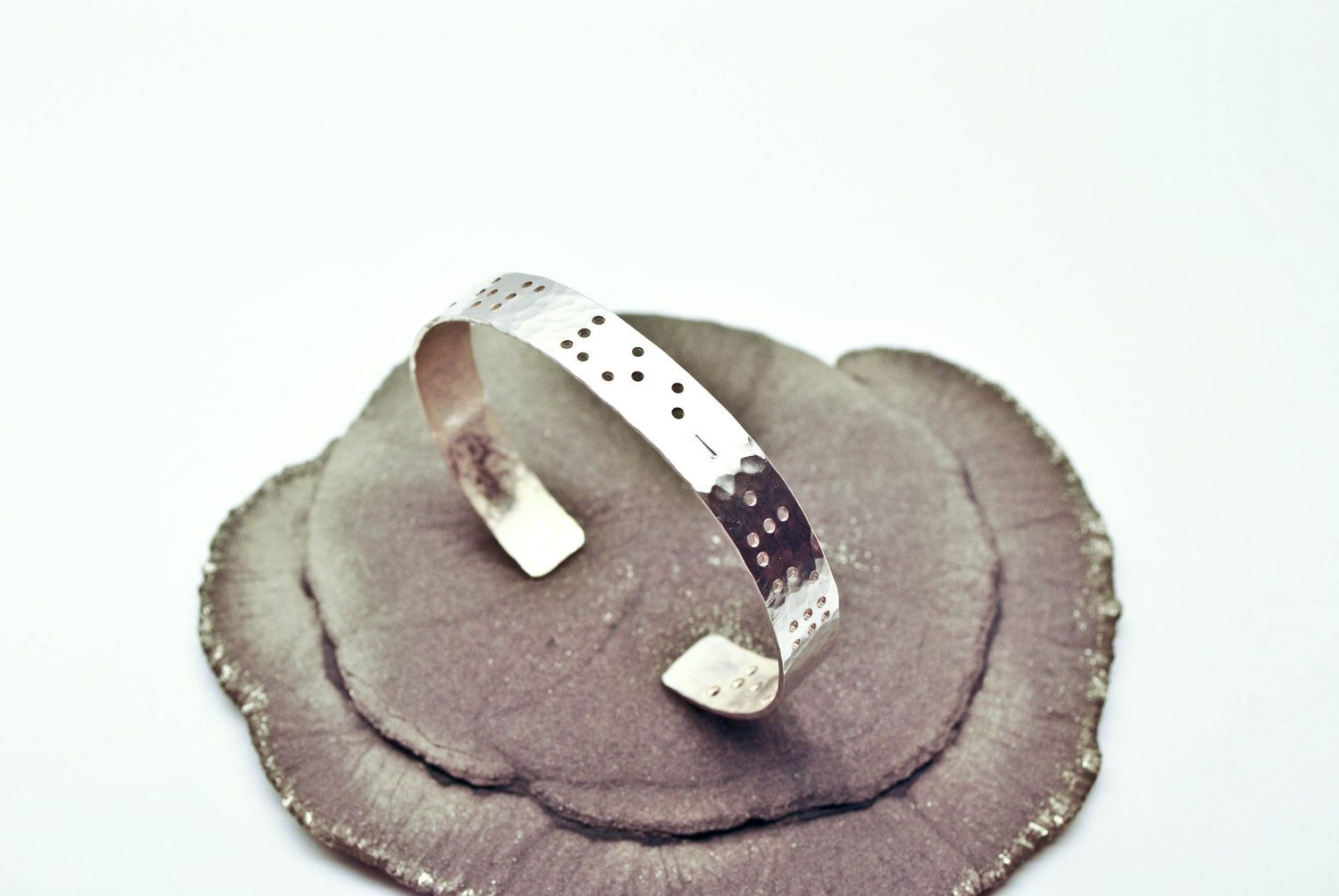 Might treat myself. BRAILLE CUFF : Personalized Sterling Silver Braille Cuff. $125.00, via Etsy.