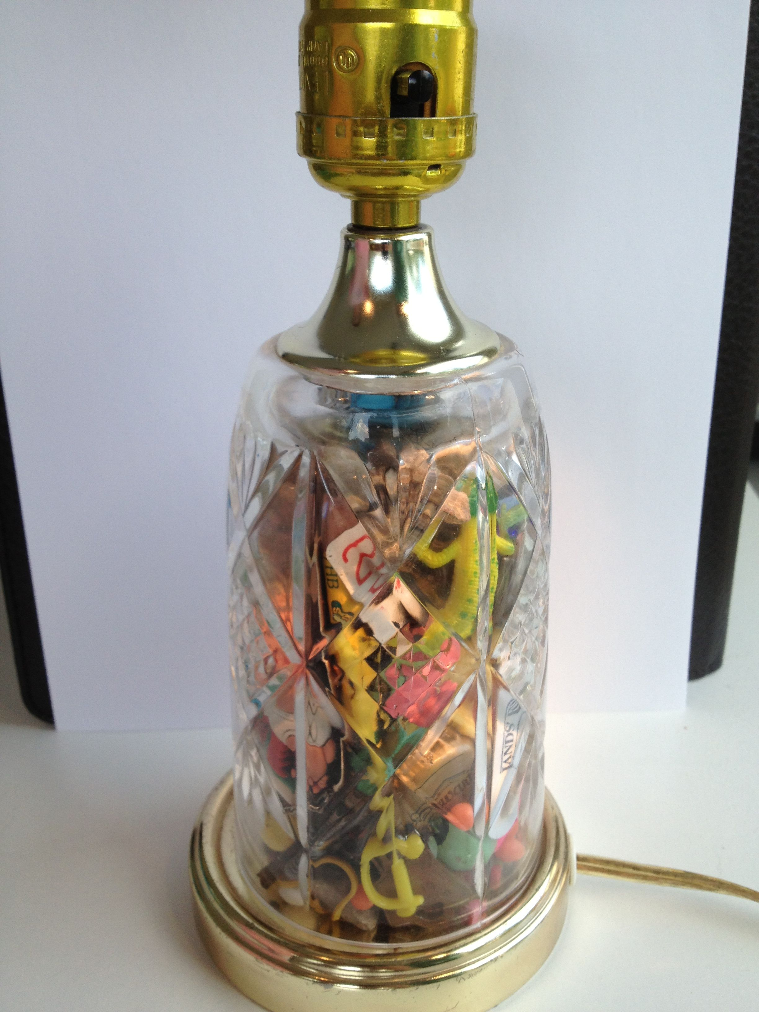 """Graduation gift idea stolen from someone on the web...a lamp filled with """"treasures"""" rescued over the last 18 years from my son's clothes before washing them...he immediately wanted to open it & pull some out..."""