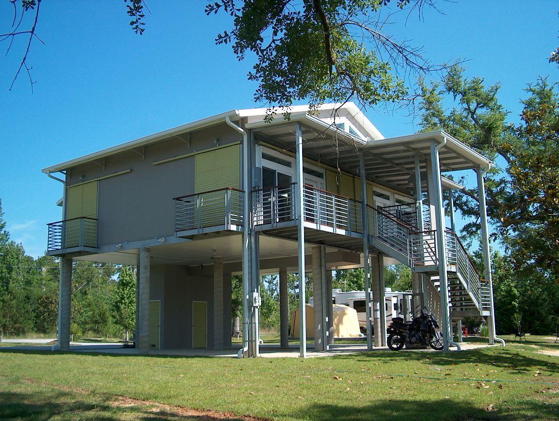 Snap-N-Lock™ energy efficient steel SIP home on stilts  | Green