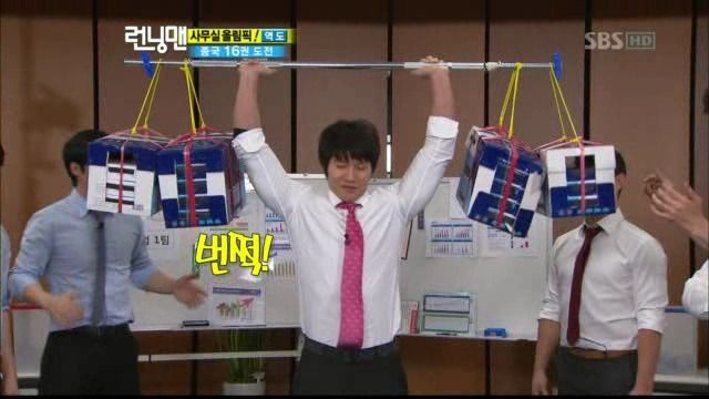 You can make a pink tie look manly by lifting crazy heavy stuff at the same time-life lesson tight by Sparta Kook