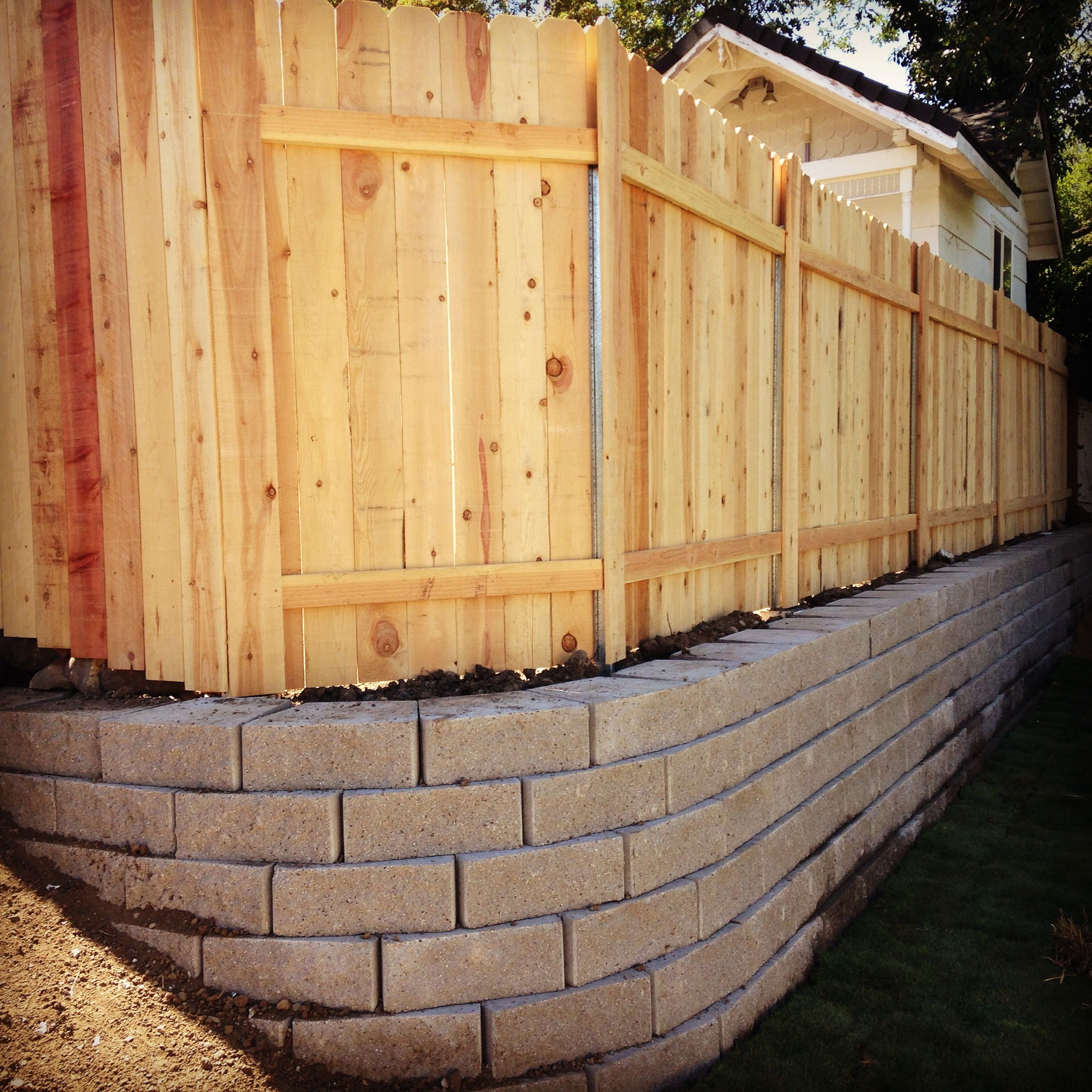 Retaining wall with fence | Backyard living | Pinterest | Medford ...