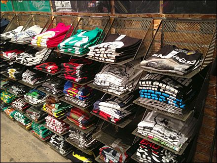 T shirt frames abused fixtures close up t shirt hat for Retail shirt display ideas