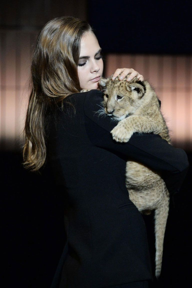 Cara Delevingne gets cozy with a lion cub for her latest project: