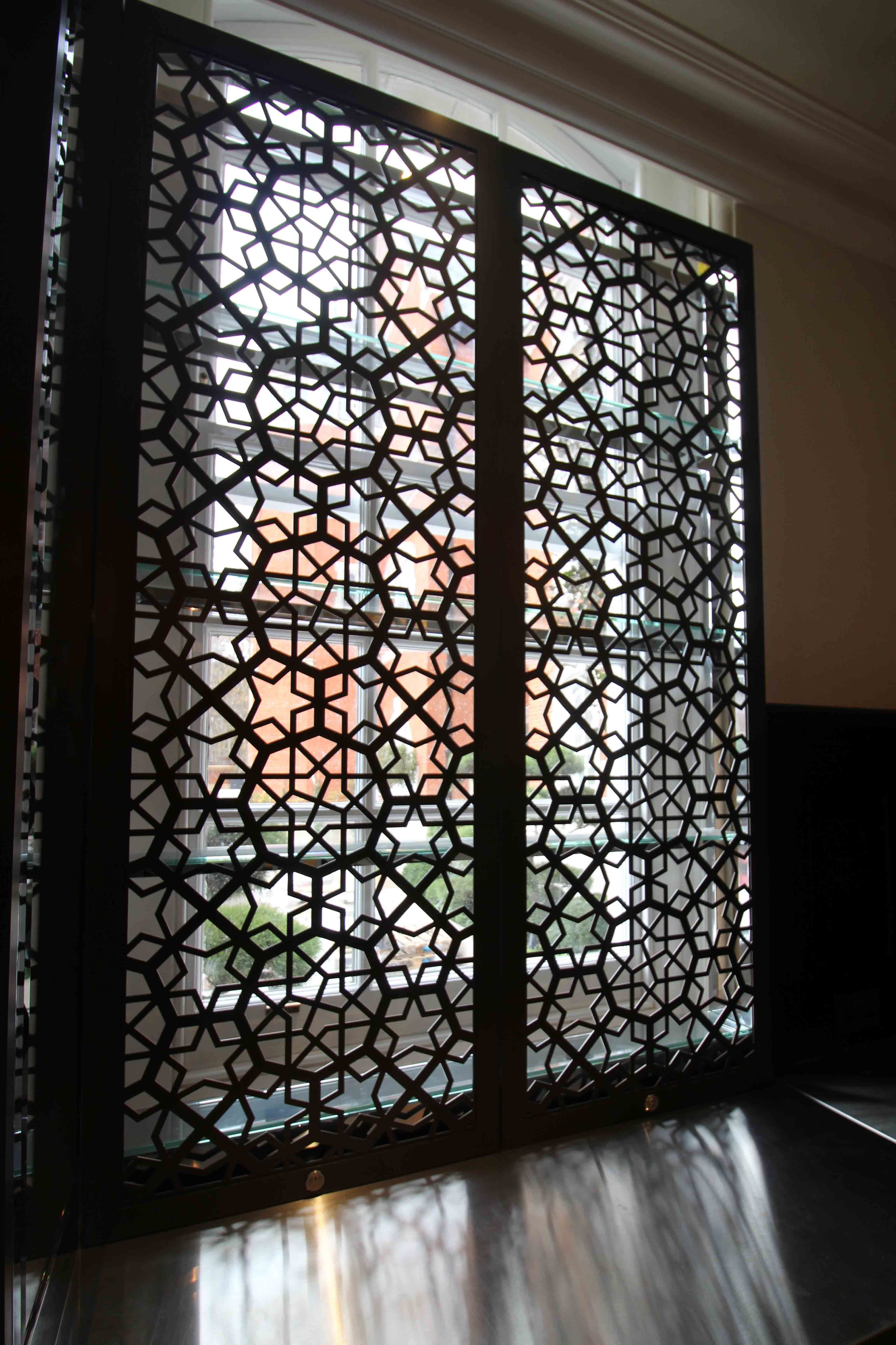 Laser cut security screens the lalit hotel london for Steel divider design