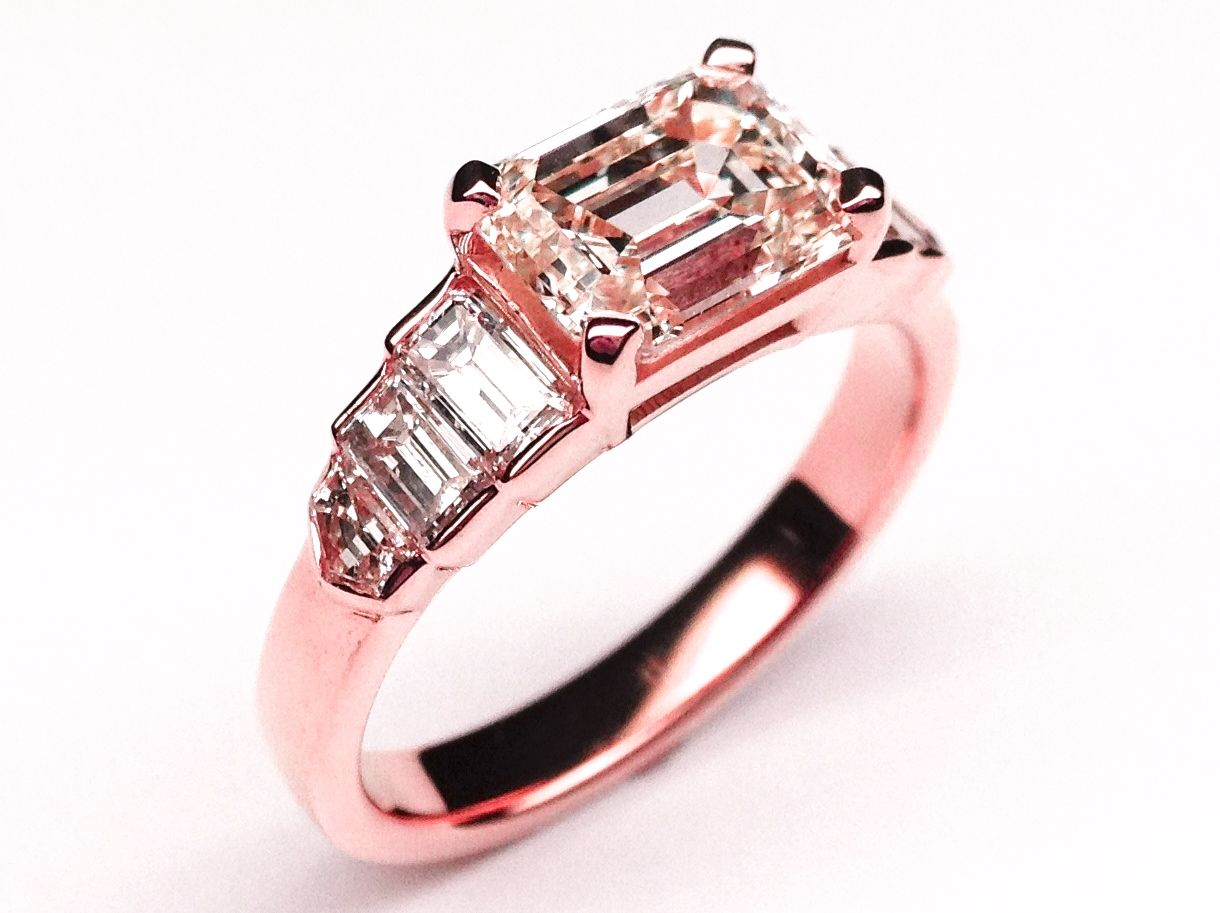 Horizontal Emerald Cut Step Up Diamond Engagement Ring In Pink Gold