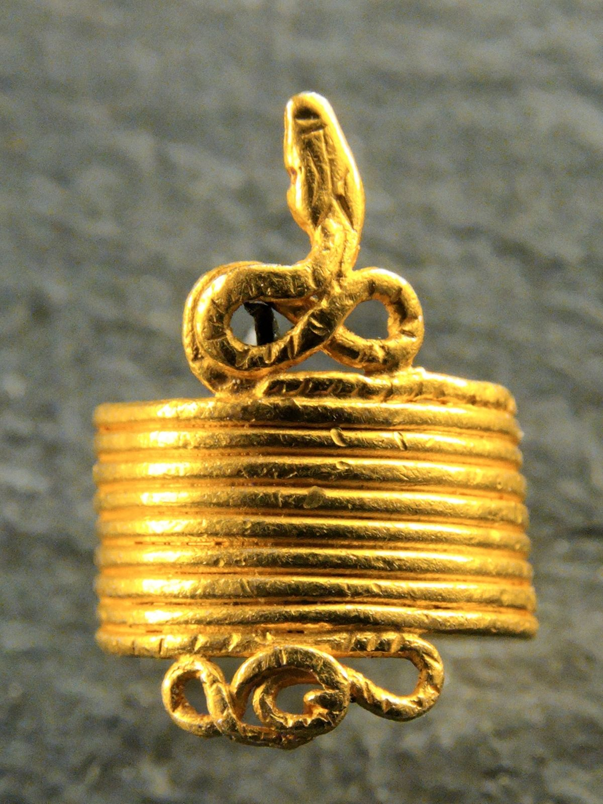 An ancient Greek snake-shaped ring dated to the 4th century BC.