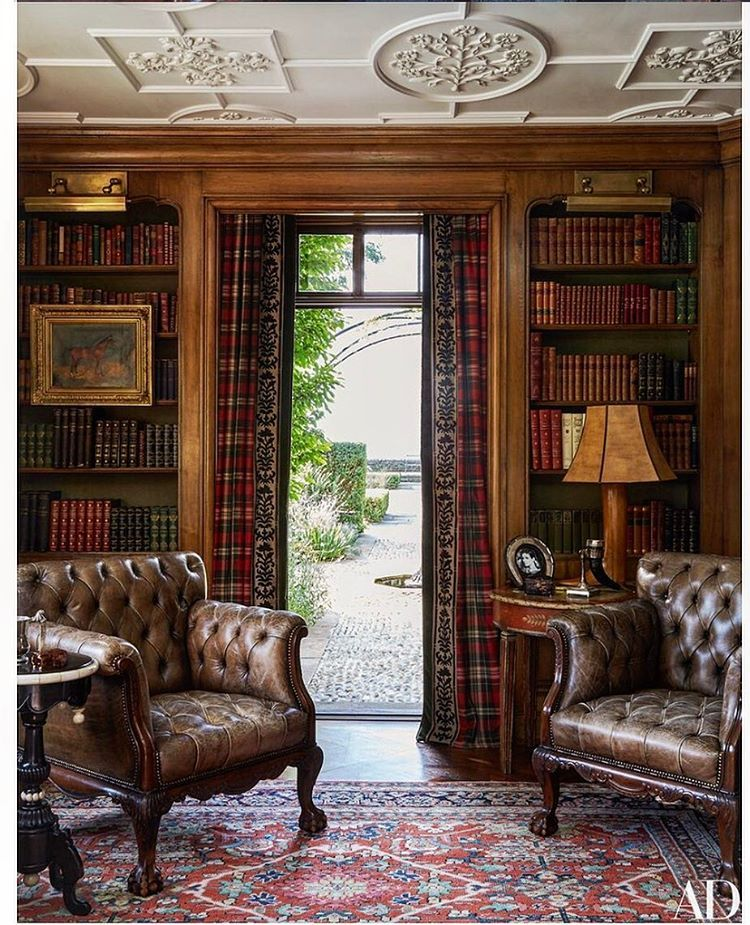 And this is the very window that captures the view from my previous post .... the library ceiling was designed in plaster to resemble that of a Tudor manor house , the oak paneling is original to the house and the leather chairs are late 19 th century. #hilfigerstyle @archdigest #coverstory #nicespottoreadthesundaypapers !