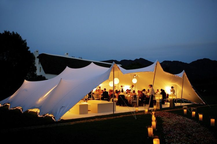 This rig has one of the longer sides open. The tent contains dinner a bar/chillout and dance floor area. Images of stretch ... & The tent is rigged with three sides down. This rig has one of the ...