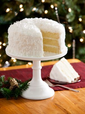 Indulge In 3 Layers Of Moist, Golden Coconut Cake With Fluffy Buttercream Icing