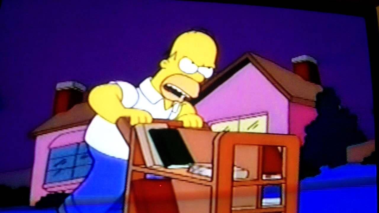 Homer enjoys riding a library book trolley homer