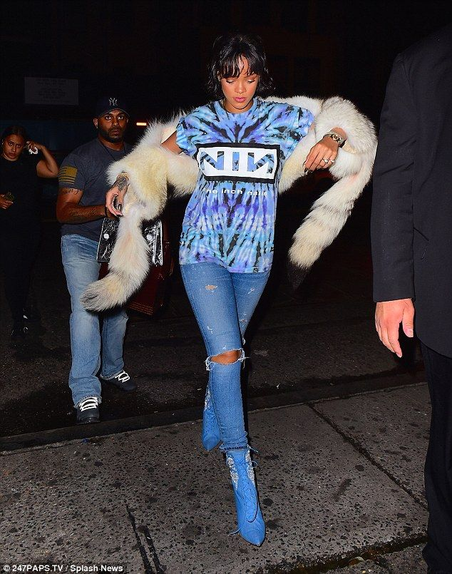 Rihanna holds face in hands after being spotted in chinchilla fur ...