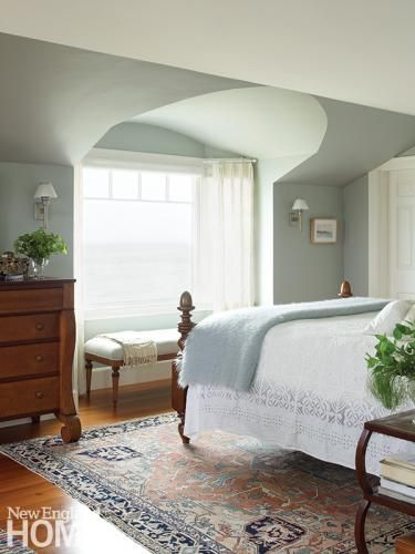 The soothing palette of this master bedroom mirrors the seascape colors outside. Architecture by George Penniman, George Penniman Architects, interior design by Nancy Taylor, Taylor Interior Design, photography by Tria Giovan Ocean Breezy | New England Home Magazine