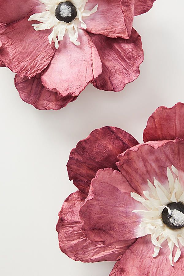 Crafted from mulberry paper, this set of flowers promises to bring a delicate touch of spring to your walls all year long.