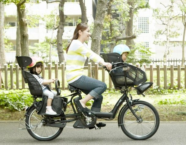 A Bicycle That Seats You Plus Two Children (If You're Okay