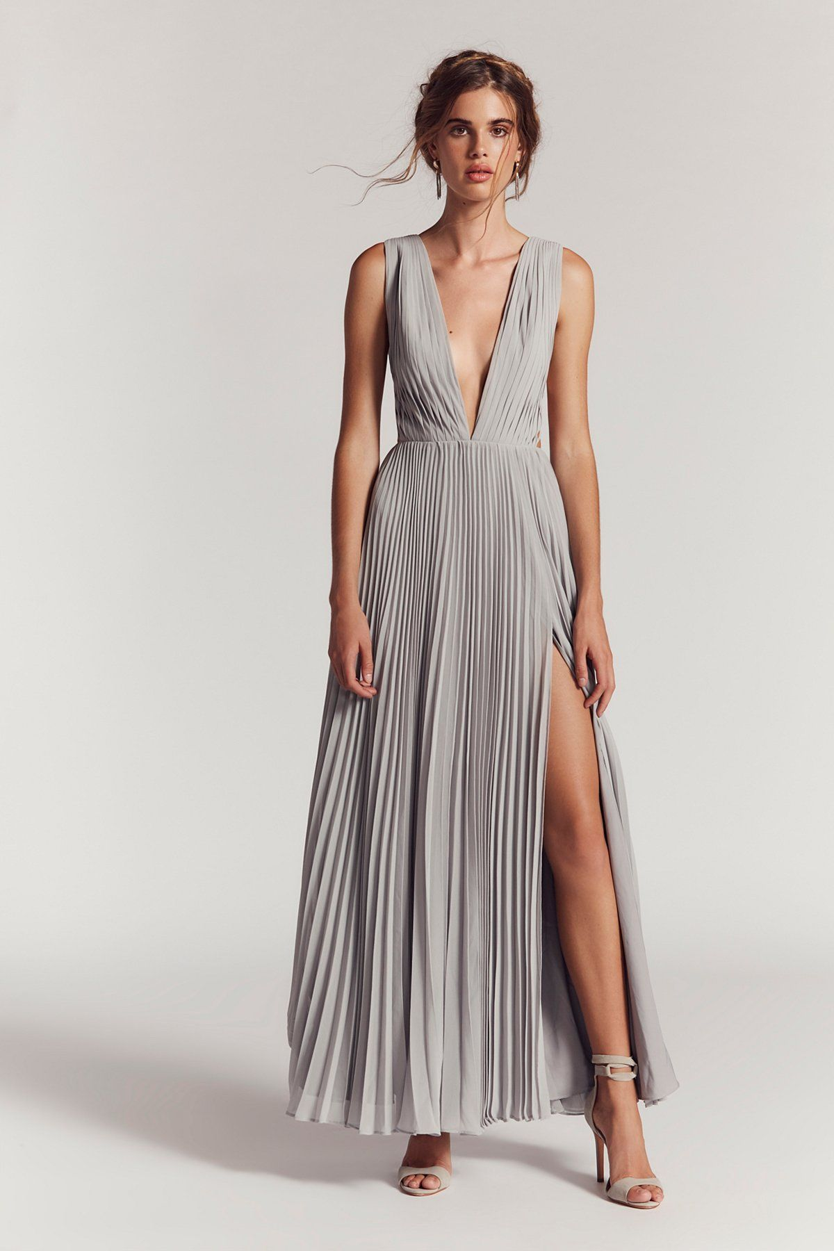 b7da216c396d5 Allegra Maxi Dress | Elegant and ethereal, this pleated maxi dress features  a plunging neckline and strappy, criss-cross details along the open sides.