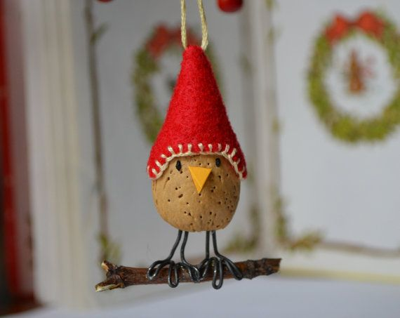 This little bird ornament is made from an almond nut.