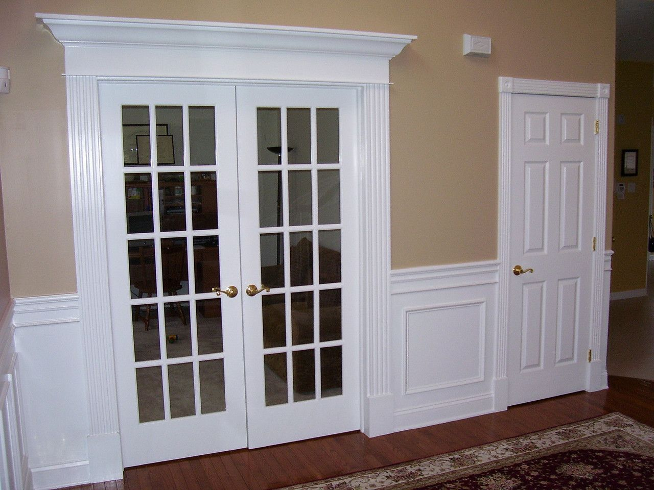 Pediment capped door with fluted casing front door for French door designs