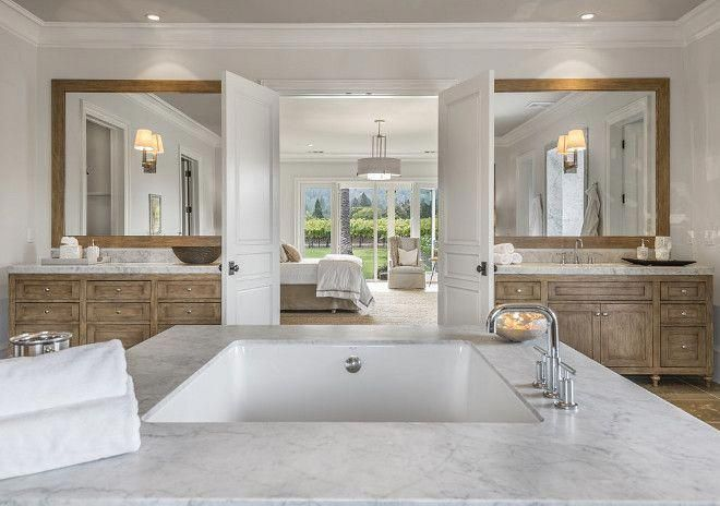 instead of two sinks in a single vanity, this master bath ...