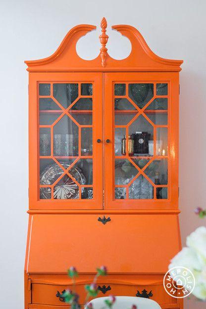 A Boerum Hill Brownstone - The armoire heirloom was give a high-gloss orange update. by Homepolish Brooklyn https://www.homepolish.com/mag/boerum-hill-brownstone?utm_source=homepolish