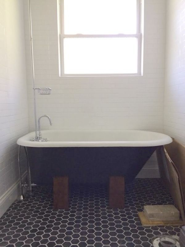 vintage tub with DIY wooden base. (modern, but not as cute as claws ...