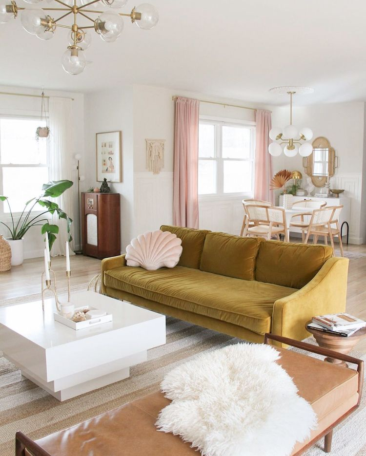 Open plan living and dining room with mustard yellow and pink accents