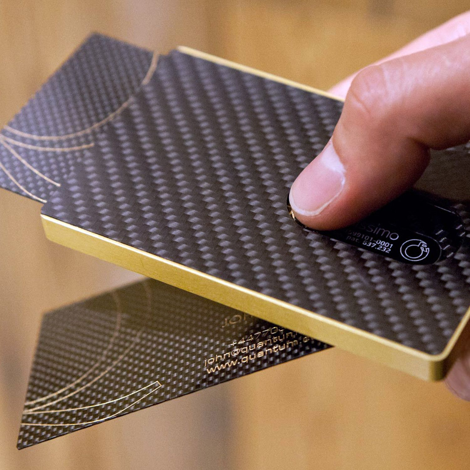 Stylish business card holdertake out a card with just a slide of carbon fibre card case gold reheart Gallery
