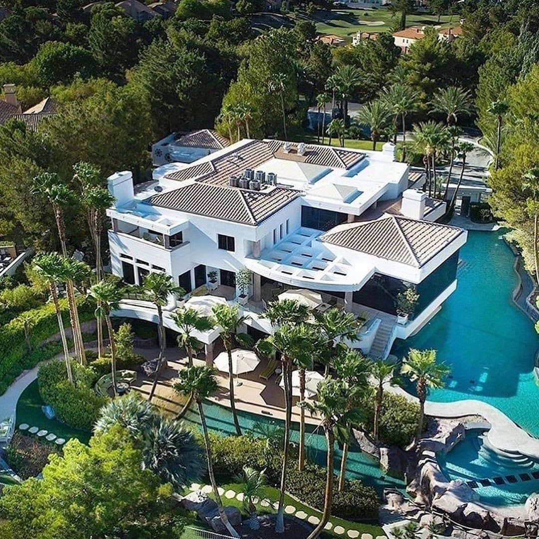Stunning 18 500 000 Mansion In Las Vegas Nv Welcome To This Tropical Paradise An Elegant 20 000 Sq Ft M Mansions Luxury House Designs Mansions Homes