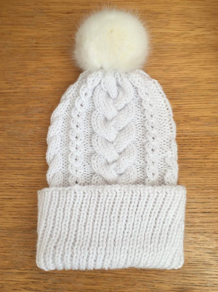White Cable Hat perfect for ski season! Find this fun pom pom hat pattern  and more winter inspiration at LoveKnitting.Com. 3dc1ae984