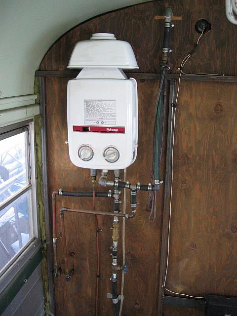 on demand water heater. i think this is the best idea for a trailer