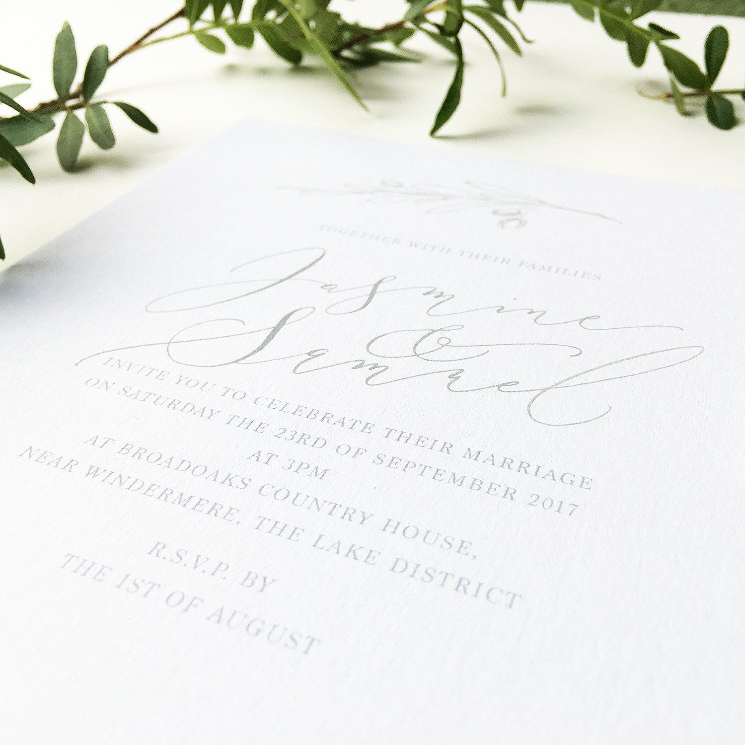 Simple olive branch calligraphy wedding invitation in palest grey