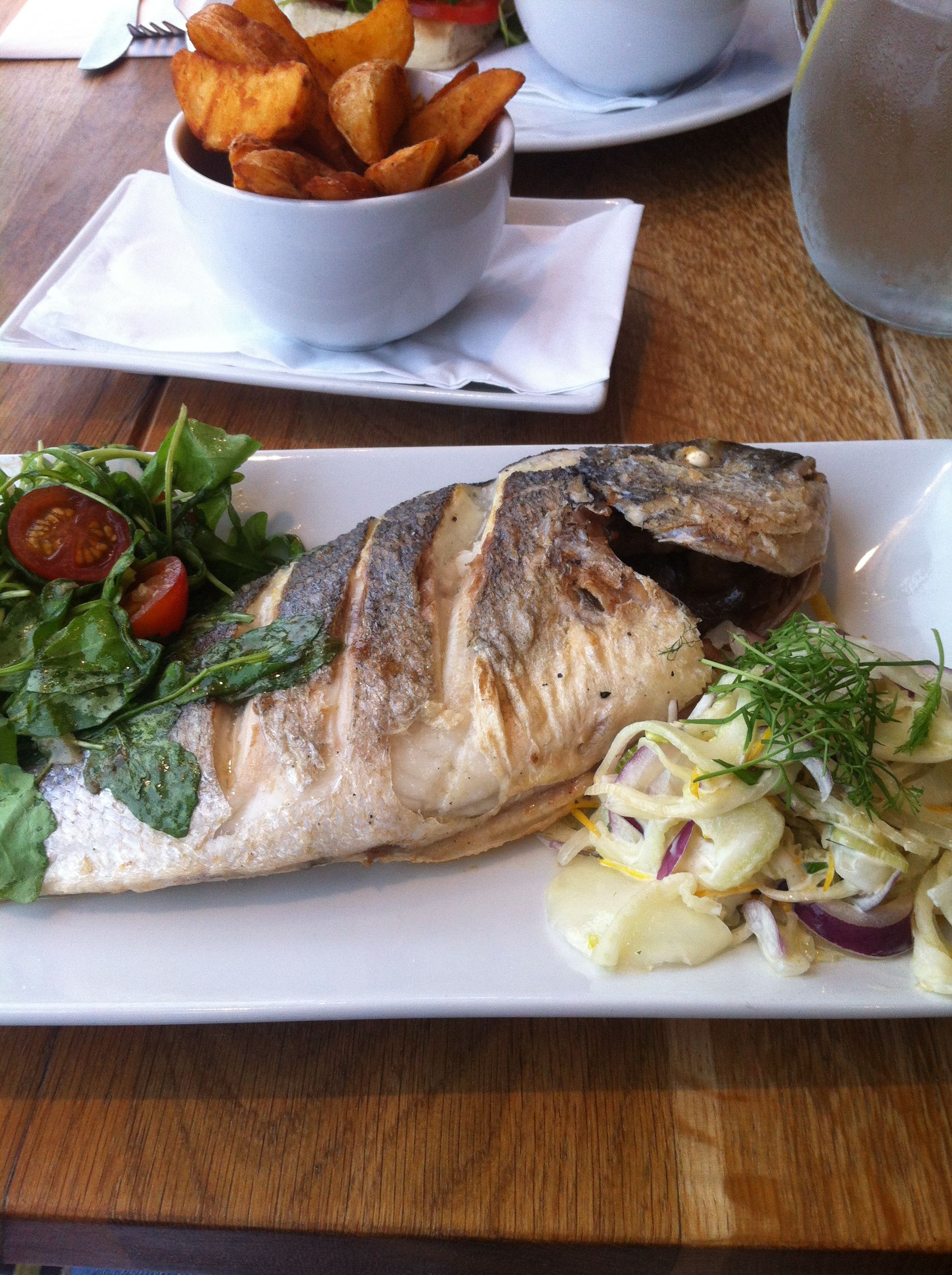 Sea Bream with fennel & apple slaw, rocket salad & spicy wedges