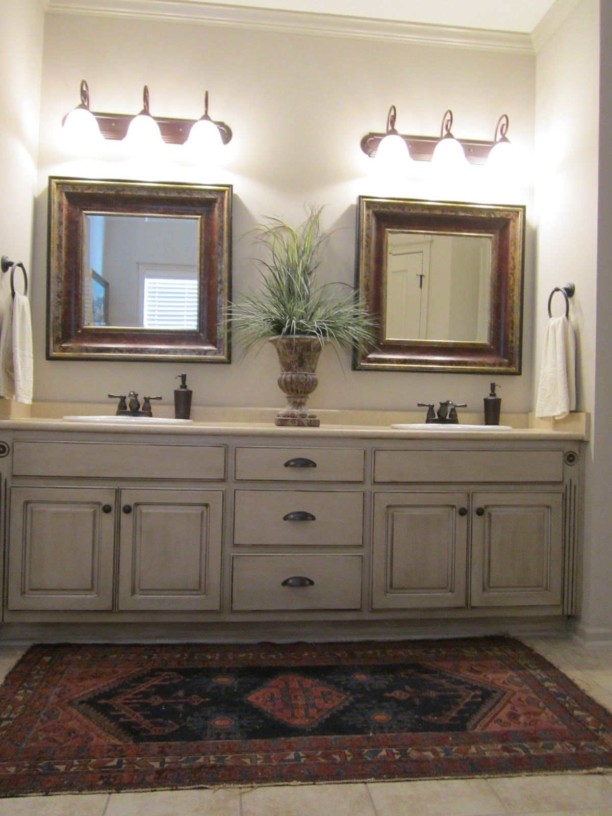 Love these painted bathroom cabinets and the lights. What