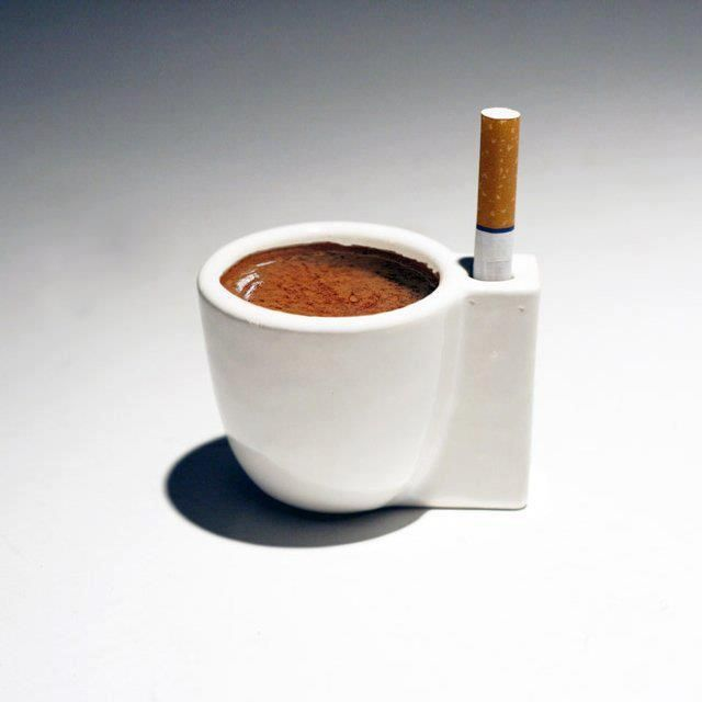 What do you see? Multi-purpose coffee cup toilet ash tray or a subtle hint to quit smoking