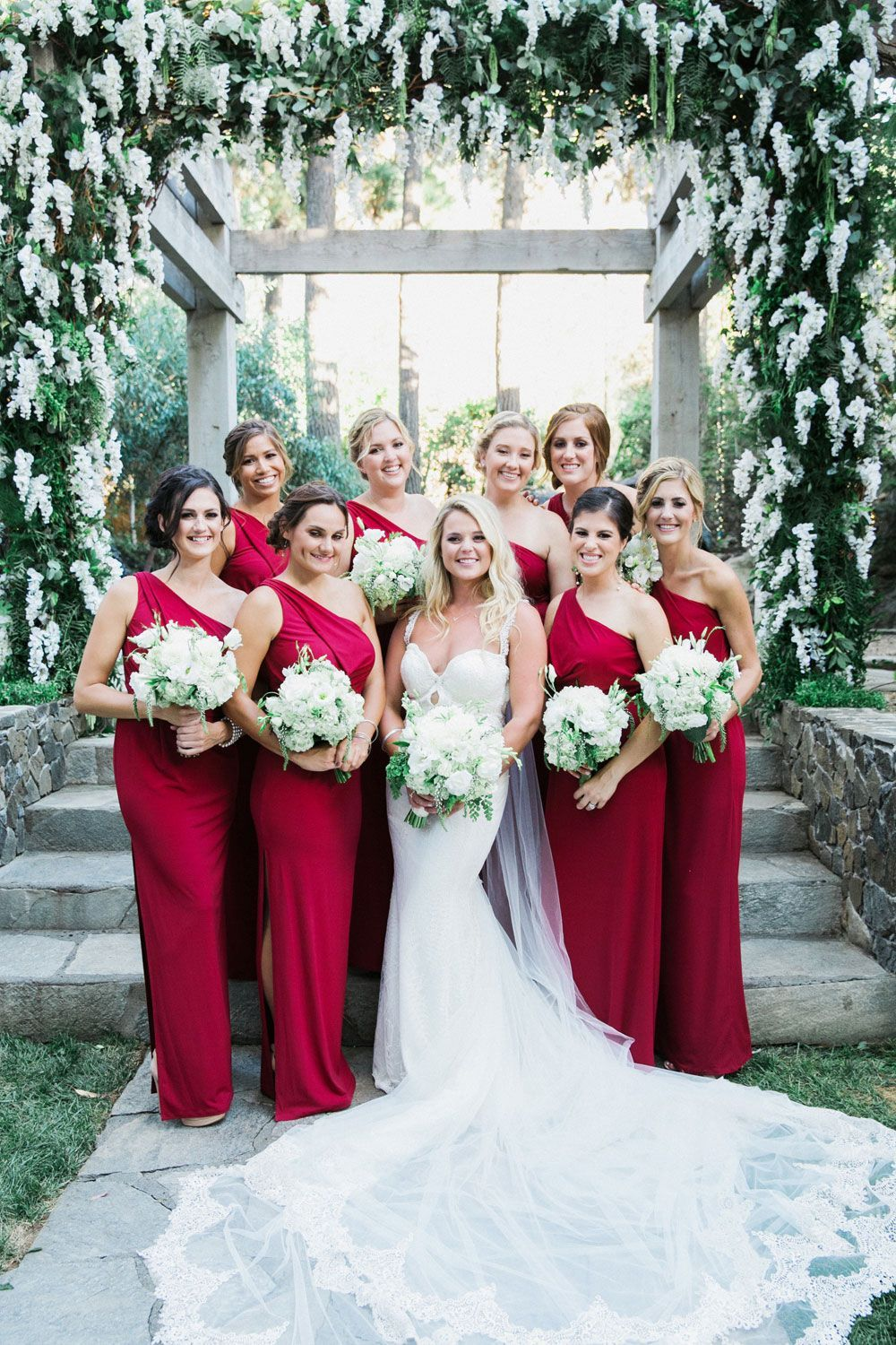 Wedding gown with red accents  Bride with Bridesmaids in Scarlet Photography This Modern Romance
