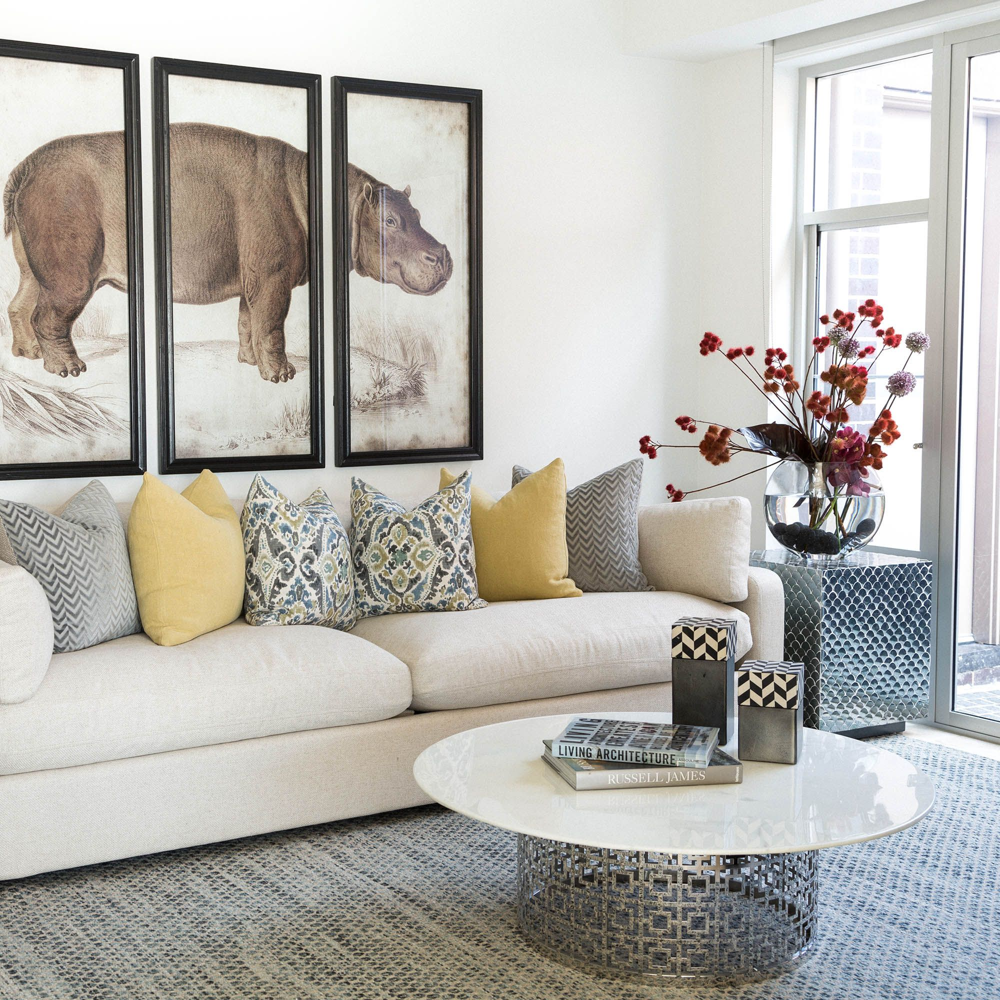 The Coco Republic Stratten Slope Arm Sofa impeccably styled with the
