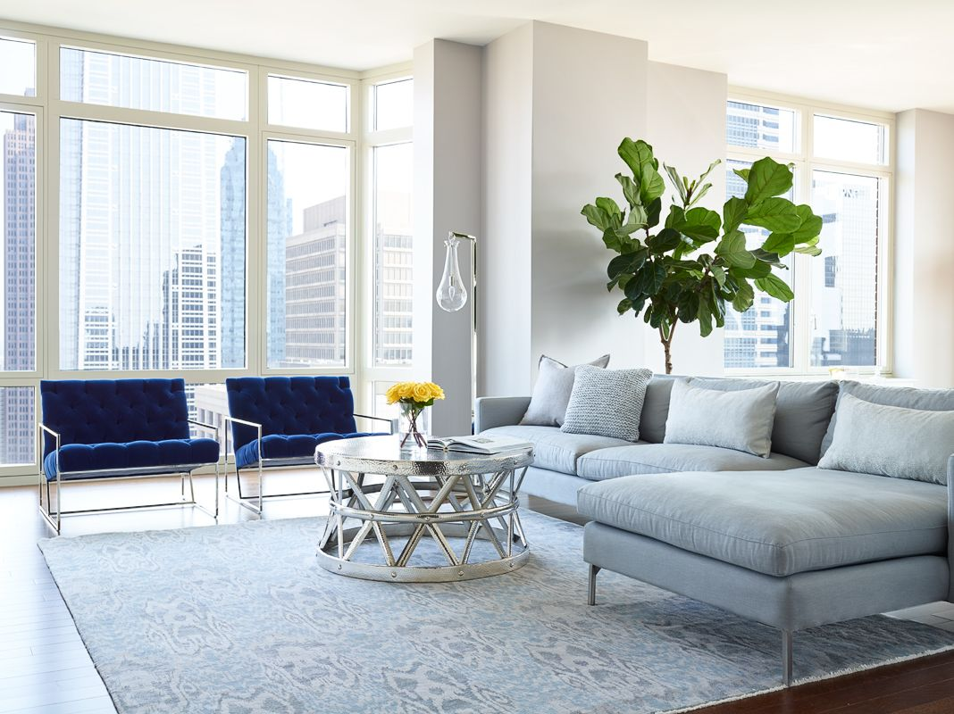 Blue Velvet Lawson Fenning chairs in high rise luxury condo