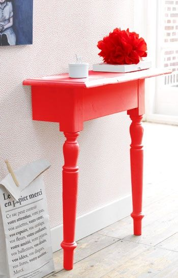 Cute! Instructions: Cut your table in half, sand the cut edges, paint it, then attach it to the wall with a ribbon and tack or L-brackets. (I would definitely use L-brackets!) Perfect for capping off the look of the hallway! I can see me doing this to get the cats' bowls off the floor.