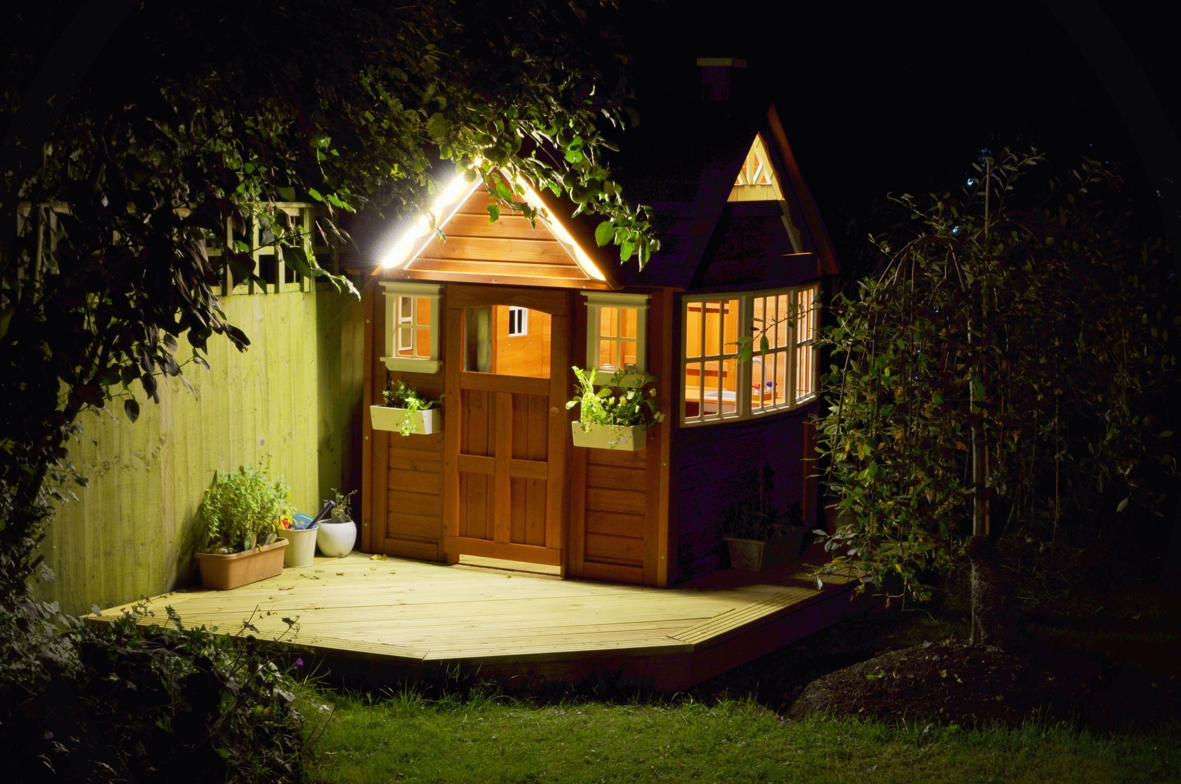 Costco playhouse augmented with deck and led strip lights