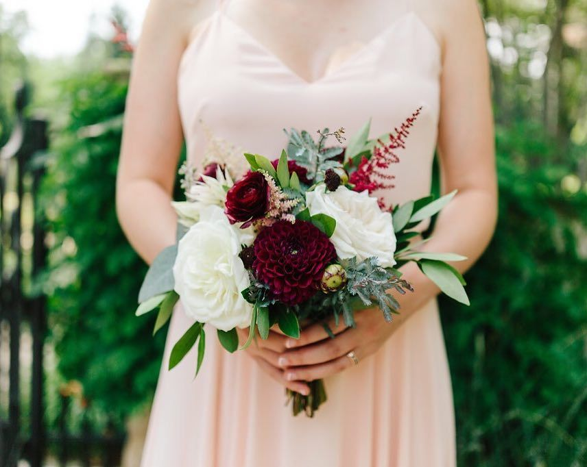 Burgundy and marsala bridesmaid bouquet featuring dahlias, roses, astilbe, ranunculus and blushing bride by Plum Sage Flowers - Photo via Lizzie Randazzo Photography #weddingbridesmaidbouquets