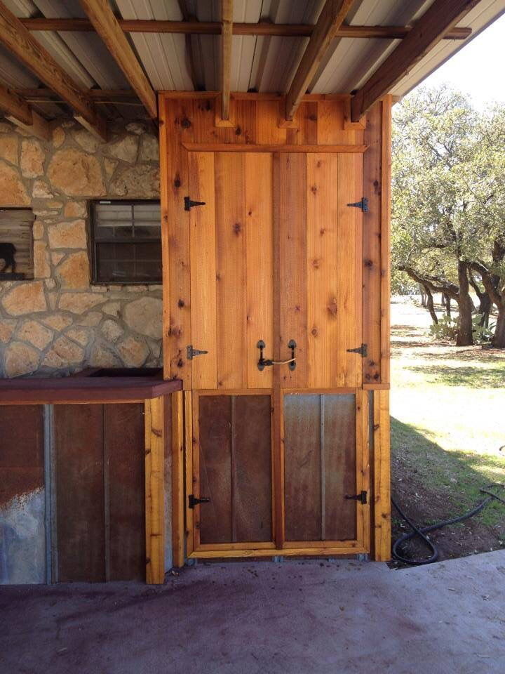 Custom cedar outdoor bar with storage cabinet and concrete countertops