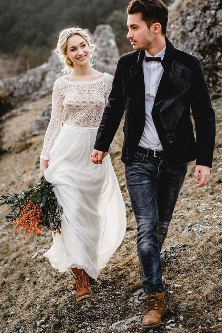 Beautiful wedding dress - love the boho bride wears boots on her wedding day #bride #coolbride #bohobride #weddingdress #longsleeve #weddinggown #bride #laidbackbride