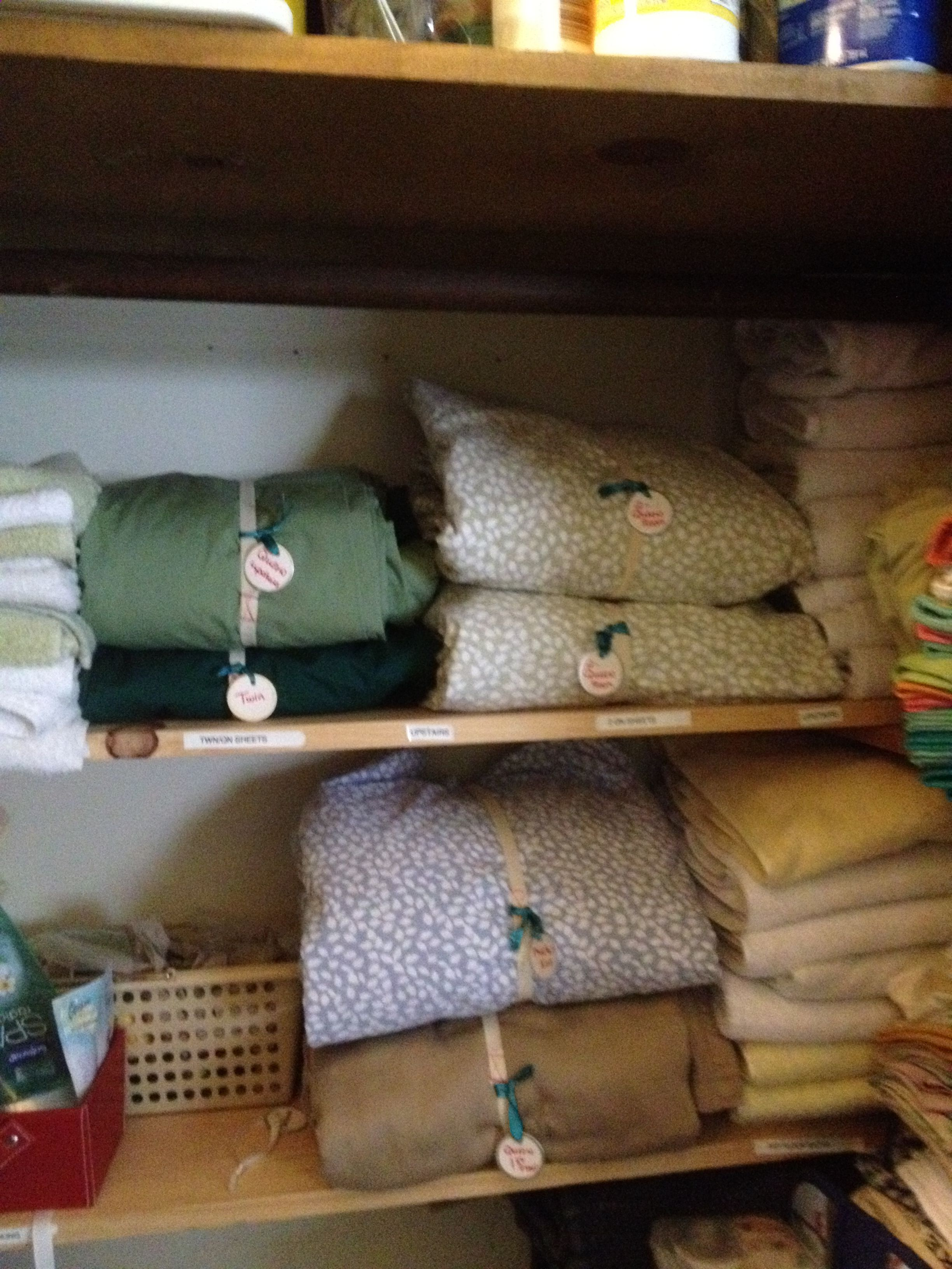 My newly organized and labeled linen closet at the beach house. Thanks Pinterest!